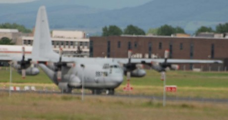 US hercules C130 warplane with Irish army escort, Shannon 27June09