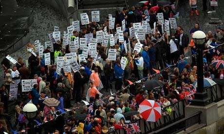 Anti-monarchy protesters gather on the banks of the river Thames at city hall, London. Photograph: Peter Macdiarmid/PA