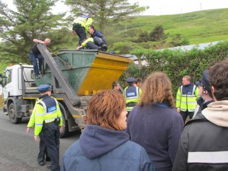 Campaigner dangerously being removed from on top of a truck