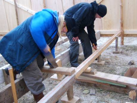 building the joists to support the floor