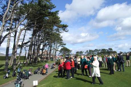 Golfers gather at the first tee in Greenore GC to watch the captains drive into office for the year 2008