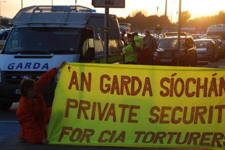 Gardai security hide their faces from the cameras