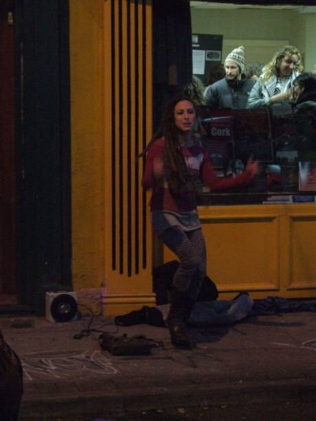 An unscheduled street performance outside Solidarity Books, evening. Bravo, Kate!