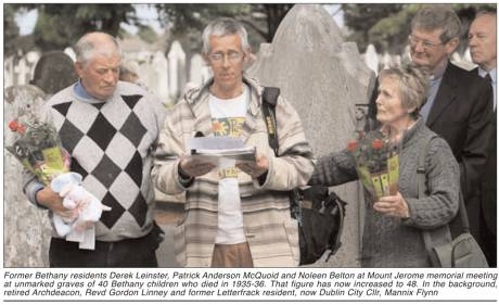 Former Bethany residents Derek Leinster, Patrick Anderson McQuoid and Noleen Belton at Mount Jerome memorial meeting at unmarked graves of 40 Bethany children who died in 1935-36. That figure has now increased to 48. In the background, retired Archdeacon,
