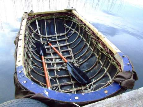 Stuart McIntyre's coracle, still under construction, hit's the water with confidence.