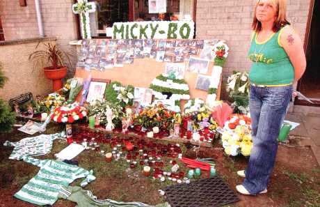 Michael's mother Gina McIlveen outside her home in Ballymena (McKay IT 13 May 06)