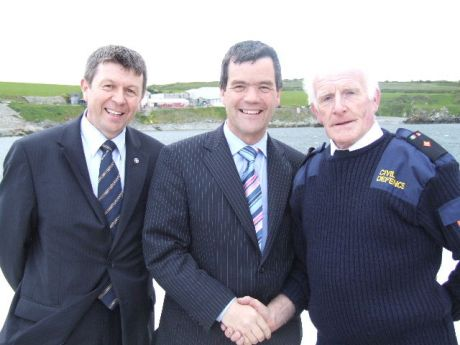 Paddy Donnelly senior executive officer in the infrastructure section of Louth county council pictured with the minister.  Paddy was MC for the opening.  On the right is James Neary, Dromiskin, a commander with the civil defence.