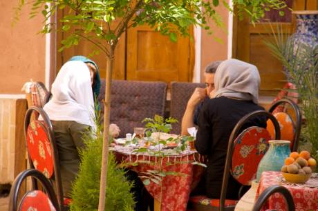 Man and two women in the traditional restaurant in the city of Yazd