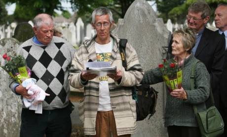 Former Bethany Home residents Derek Leinster, Patrick Anderson McQuoid and Noleen Belton attend a memorial service at the unmarked graves of 40 children from the home in Mount Jerome cemetery in Dublin