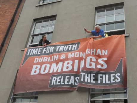 Sinn Féin hang large banner in Parnell Square + publishes Dáil motion bombings