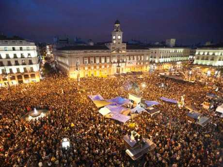 About 20,000 young people angry over high unemployment have spent the night camping in a famous square in Madrid as political protest grows.