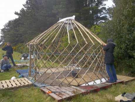 Putting up the yurt in the new field
