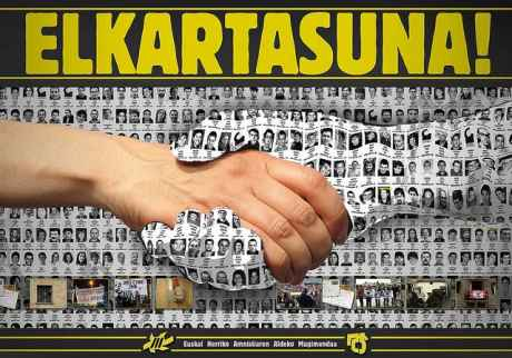 A poster of some of the 600 prisoners becomes a hand, gripping the hand of solidarity