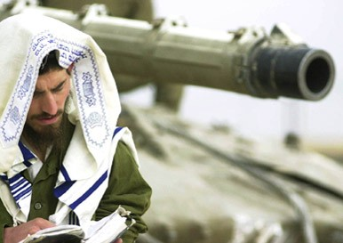 "Peaceful Jewish Chap praying to his ""God"" while sitting on his Fully armed and dangerous Merkava Tank"