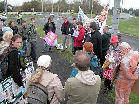 23 gather in Lidl carpark and prepare to march to Shannon Warport
