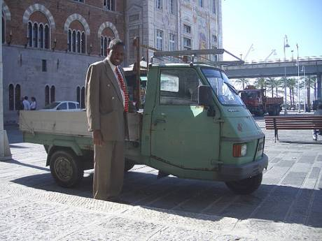 Nick Macharia with the little 3 wheeler he took such a liking to in the Genovese waterfront