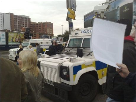 PSNI film the SF protest as Loyalists attack