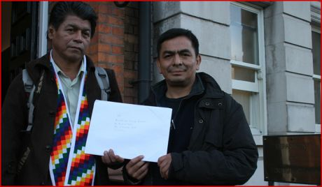 Cristian on left and his comrade and colleague, José at Department of Justice today.  © Michael Gallagher 2009