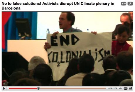 END Co2-Lonialism -  BCN activists disrupt plenary and are met with thunderous applause