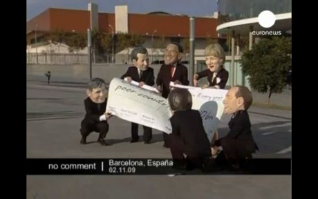 Action outside the conference - World leaders draw up aid cheque to poor countires, then rip it up