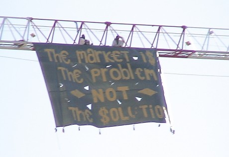 """Markets are the problem, not the solution"" Banner drop at closing day of Barcelona climate talks"