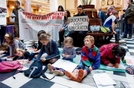 Occupy Cork protest holds maths class in bank