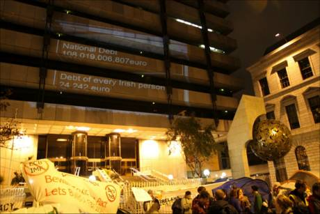 Tent Town @ Dame street + Irish debt figures projected onto Central Bank