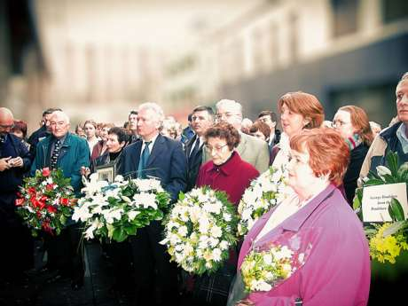 Relatives, Dublin Bus workers, friends and supporters gather to lay wreaths and flowers at the 30th anniversary