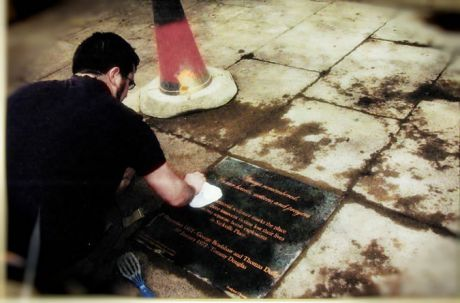 A close up of Tom working on the plaque in 2004