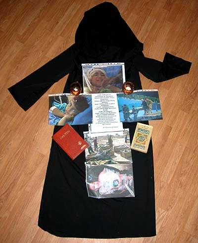 Shrine and Burqa with Bible and Qu'ran, Photos off Iraq War Casualties