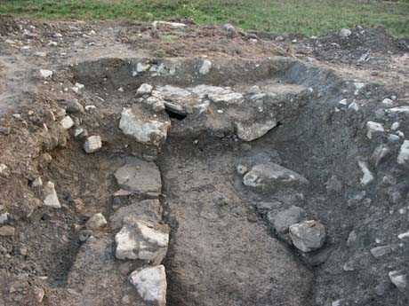 Picture of the Souterrain from the site which is now nothing but a pile of stones at the entrance to the site
