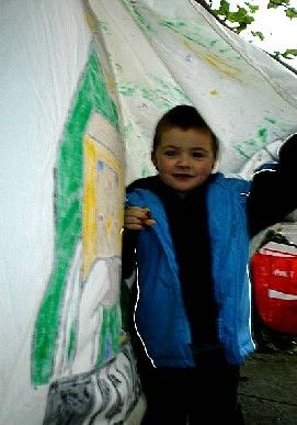 Young Master MacGregor Makes A Tent From A Banner