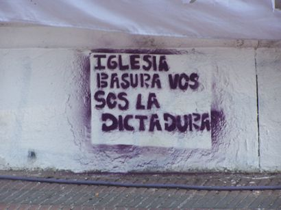 """Church, you Trash, you are the Dictatorship"". Graffiti makes reference to the Church's collaboration with state terrorism."