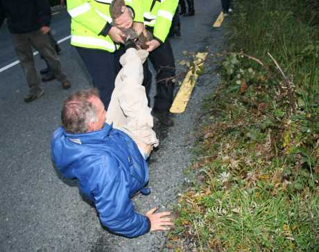 An old man is dragged into the ditch