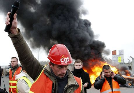 Oil worker and union representative Christophe Hiou delivers a speech as workers protest near the oil refinery in Donges, near Nantes