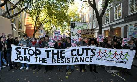UK> 3,000 people gathered in London to protest against the government's public spending cuts.