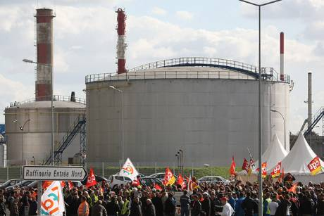 Strikers block the entrance to the Total refinery in Donges