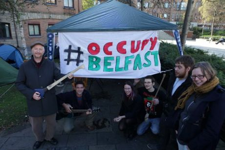 Billy Bragg with Occupy Belfast (with hurl in hand...)