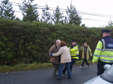 Proters being pushed and pulled around by Garda�