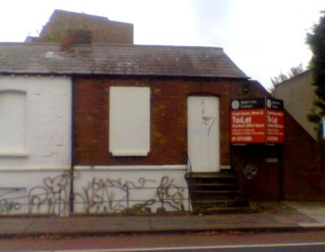 Boarded up cottage along Canal Road, Dublin