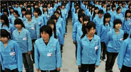 Foxconn workers line up military style before work.