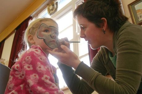 Face-painting during a children's activities day at Nicholas of Myra in February 2006