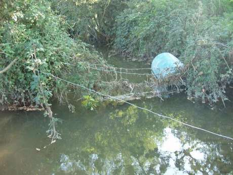 The Gabhra River stagnant and polluted at the foot of Barrow 53