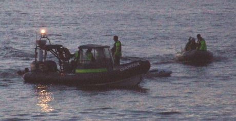 Gardaí sandwich S2S activists between ribs - 3. S2S boat crew in water and cops in after them.