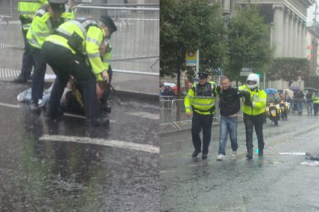 Garda� arresting two protestors