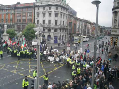 A section of the crowd lining O'Connell Street and Abbey Street