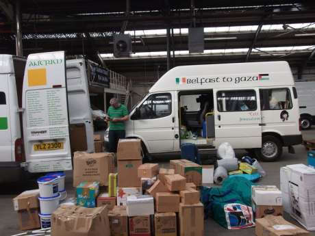 Belfast and Antrim crews loading humanitarian aid